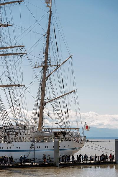 Stern with Japanese flag and mizzen mast of Kaiwo Maru, Steveston pier, British Colulmbia