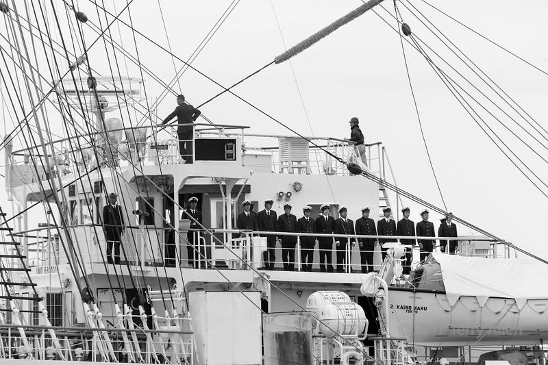 Kaiwo Maru ready to leave port, officers on bridge, pilot on flying bridge, B&W  Steveston, BC