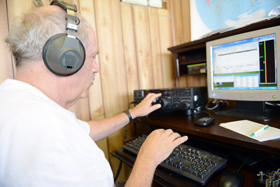 John Thompson, of Winfield, uses a ham radio during the Susquhanna Valley Amateur Radio Club's Field Day at the Penn Valley Airport on Saturday afternoon in Selinsgrove.