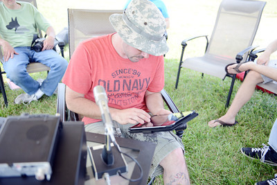 Justin Blocker, of Selinsgrove, uses his iPad to look at where other ham radio users are located across the country on Saturday afternoon during the Susquhanna Valley Amateur Radio Club's Field Day at the Penn Valley Airport in Selinsgrove.