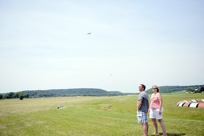 Elwin Peachey, of Selinsgrove, and Jo Rusesky, of Harrisburg, watch as planes fly overhead during the Barnstorming competition at the Penn Valley Airport in Selinsgrove on Saturday afternoon.