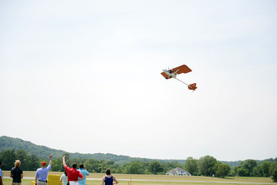 "A man flying a ""kit"" plane waves to the crowd below during the Barnstorming competition at the Penn Valley Airport in Selinsgrove on Saturday afternoon."