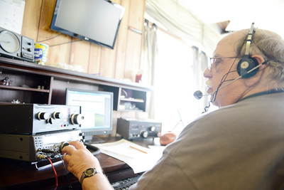 "David Welker, of Sunbury, uses a ""ham"" radio during the Susquhanna Valley Amateur Radio Club's Field Day at the Penn Valley Airport on Saturday afternoon in Selinsgrove."