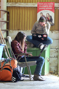 Patti Arbogast, 16, left, and her sister Jackie, 14, of Mount Pleasant Mills, use their laptops while taking a break at the Beaver Springs Fair on Monday morning.