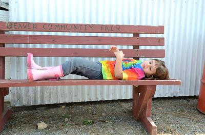 Rebekah Hollenbach, 5, Beaver Springs, takes a break from the Beaver Springs Fair on Monday morning.
