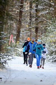 Despite the snow and cold, runners made their way along the course at the CJ's Resolution Challenge fun run on Saturday at R.B. Winter State Park to help fight autism.