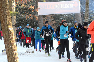 Runners take off at the start of the CJ's Resolution Challenge on Saturday at the R.B. Winter State Park to help fight autism.