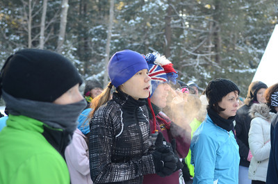 Allison Machnicki, left, and Robert Baguley, take breaths of cold air before the start of Saturday's CJ's Resolution Challenge fun run to help fight autism.
