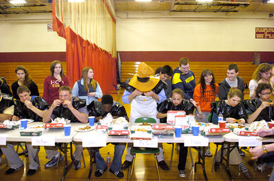 Teachers and students at the Selingrove High School participated in a chicken wing eating contest on Thursday put on by the National Honor Society.