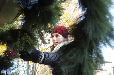 Selinsgrove High School senior Maggie Lemons, 17, helps decorate the Selinsgrove downtown on Monday morning.