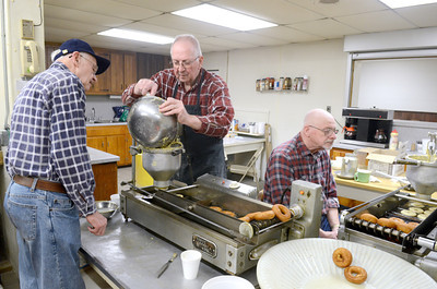 Volunteers LaRue Thoman, left, Beavertown, Melvin Will, Beavertown, and Dale Hackenberg, Beavertown, help mix up around 900 dozen donuts on Monday at the Beavertown Rescue Hose Company for donut day today.