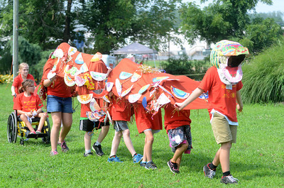 A hand made Chinese Dragon makes its way during a play put on by kids at the Kidsgrove art camp in Selinsgrove on Friday.