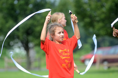 Jasayle Rivera, 8, Port Trevorton, waves her ribbons during a play put on by kids of the art camp at Kidsgrove in Selinsgrove on Friday.