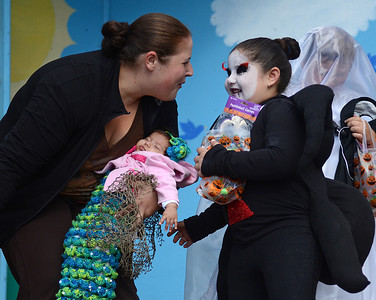"Elenne Mitsigiorge, of Northumberland, congratulates her daughter Gabriela, 5, for winning a top prize for the ""scariest costume"", while holding her another daughter Sofia, 2.5 months, who won the ""cutest infant costume"" award at the Kidsgrove Fall Festival in Selinsgrove on Saturday afternoon."