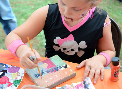 Andraya Faust, 8 of Sunbury, decorates a brick which will be used to decorate Kidsgrove at the Kidsgrove Fall Festival on Saturday afternoon in Selinsgrove.