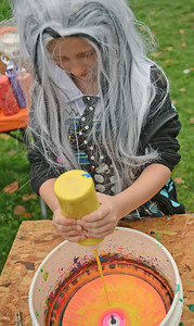 Kaitlyn Fennessy, 7 of Selinsgrove, creates spin art at the Kidsgrove Fall Festival on Saturday afternoon in Selinsgrove.