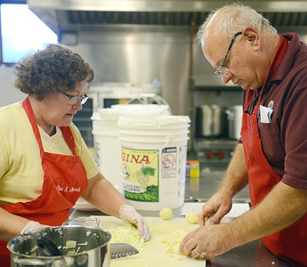Michelle and Mike Schlenker, of Selinsgrove, cut vegetables for Maryland Crab Soup at St. Pius X Church in Selinsgrove on Tuesday evening. The Schlenkers have been helping make this soup for the Market Street Festival for about five years.