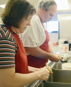 Pattie and Jack Kircher, of Selinsgrove, peel potatoes for Maryland Crab Soup on Tuesday evening at St. Pius X Church in Selinsgrove.