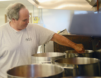 Jack Kircher, of Selinsgrove, stirs Maryland Crab Soup at the St. Pius X Church in Selinsgrove on Tuesday evening. Kircher has been helping make this soup for the Market Street Festival for about five years.