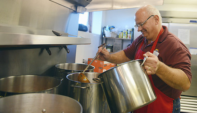 Mike Schlenker, of Selinsgrove, makes Maryland Crab Soup on Tuesday evening at St. Pius X Church for the Market Street Festival.