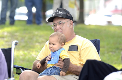 Darvin Ort, McClure, holds his grandson Karben Boring, 10 months old, Lewistown, on his lap at the Bean Soup Festival in McClure on Sunday evening.