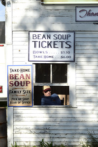 Barry Goss, McClure, sells tickes for the bean soup at the Bean Soup Festival in McClure on Sunday.
