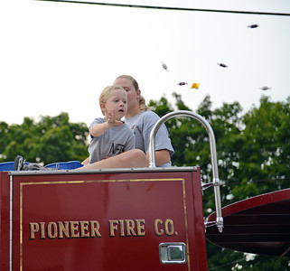 Amanda August/For The Daily Item Candy is thrown from one of the 15 firetrucks in the Middleburg Fireman's Carnival on Thursday night.