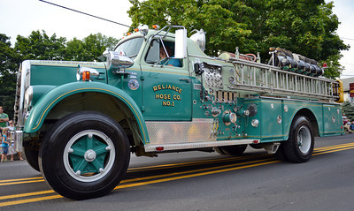 Amanda August/For The Daily Item There were about 13 fire companies and three private firetrucks in this year's Middleburg Fireman's Carnival Parade on Thursday night.