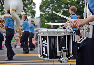 Amanda August/For The Daily Item A drummer of the Midd West High School Marching Band plays during the Middleburg Fireman's Carnival on Thursday night.