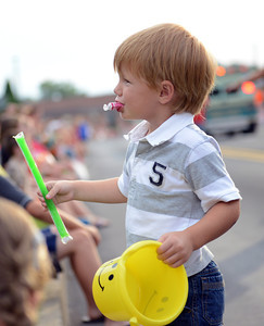 Amanda August/For The Daily Item Kaden Horst, 3 of Mount Pleasant Mills, shows his dad the ice pop he received during the Middleburg Fireman's Carnival on Thursday night.