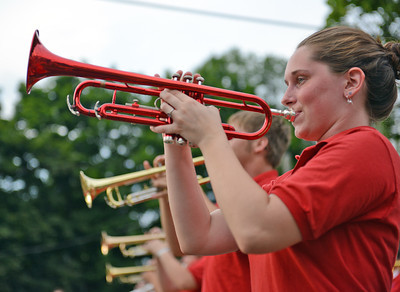 Amanda August/For The Daily Item A trumpeter in the Selinsgrove Area High School Marching Band performs in the Middleburg Fireman's Carnival on Thursday night.