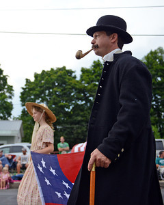 Amanda August/For The Daily Item Civil War re-enactors participate in the Middleburg Fireman's Carnival on Thursday night.