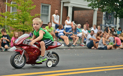 Amanda August/For The Daily Item Lathan Good, 4 of Middleburg, rides a miniature motorbike during the Middleburg Fireman's Carnival on Thursday night.