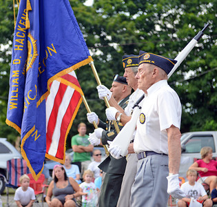 Amanda August/For The Daily Item An honor guard starts the Middleburg Fireman's Carnival on Thursday night.