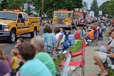 Amanda August/For The Daily Item A crowd gathers to watch the Middleburg Fireman's Carnival on Thursday night.
