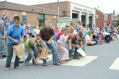 Kids scramble for candy Thursday night at the Middleburg Fireman's Parade.