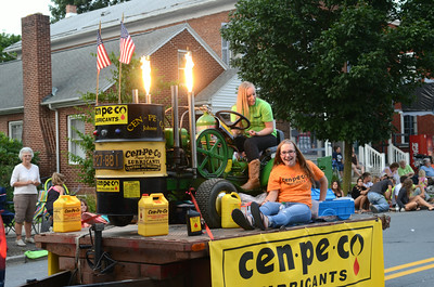Kassondra Walters, 18, left, and Caitlyn Feaster, 14, man the Cen-Pe-Co float in the Middleburg Fireman's Parade on Thursday evening down Main Street.