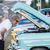 Robert Inglis/The Daily Item  Matt Dorman of MIfflinburg checks out a classic car at the Mifflinburg Hose Company carnival on Friday evening.
