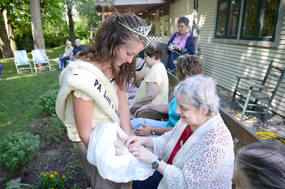 The PA Lamb and Wool Queen Ashley Shaw, left, Harrisburg, lets Elaine Noll, Mifflinburg, who is blind, touch some of the sheep clippings she brought with her on Monday to the Penns Creek Adult Resource Center.