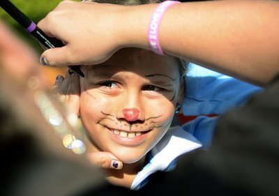 Kylee Wertz, 9, of Shamokin Dam waits to be transformed into a cat at one of the booths during the 34th Annual Market Street Festival in Selinsgrove Saturday Sept. 22, 2012.