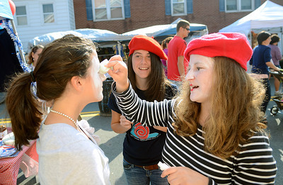 Catherine Lucchi, 15, from left, Maria Lucchi, 15, and Anne Coyne, 15, prepare to head out into the crowed to promote Selinsgrove High Schools French Club Saturday Sept. 22, 2012 during the annual Market Street Festival.