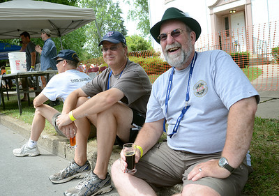 Steve Fairbrother, right, shares a laugh and some beer with friend, Brian Adams, of North Wales during Selinsgrove's annual brewfest Saturday July 21, 2012.
