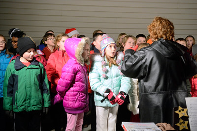 Selinsgrove fourth grade students sing a Christmas song at the annual tree lighting ceremony in Selinsgrove on Tuesday night.