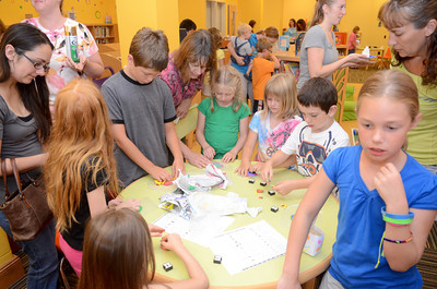 Kids with help from their parents made Egyptian artifacts at the Selinsgrove Library on Monday morning as part of their summer reading program.