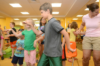 Andrew Morris, 9, does his best Egyptian dance on Monday morning at the Selinsgrove Library for their summer reading program.