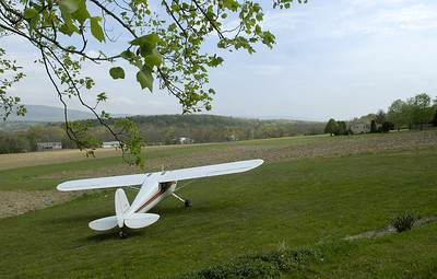 "A plane sits next to the airstrip at the Snook residence in Beaver Springs where they host ""Snook Saturdays"" for fellow aviation fans to get together and be hanger pilots."