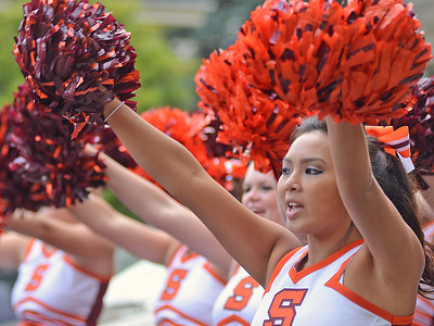 Susquehanna University Cheerleader Dalyna Ngo cheers during the university's homecoming parade on Saturday afternoon in Selinsgrove.