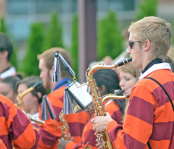 The Susquehanna University Stadium Band performs on the corner of Pine Street and Market Street in Selinsgrove on Saturday afternoon during the Homecoming Parade.