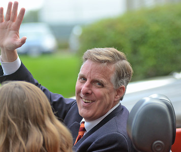 Susquehanna University President L. Jay Lemons waves during the university's homecoming parade on Saturday afternooon in Selinsgrove.