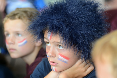 Colin Findlay, 8, Selinsgrove, intently watches the USA men's soccer match against Germany on Thursday while attending a soccer camp at Susquehanna University.